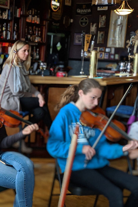 fiddlers of all ages playing at community jam