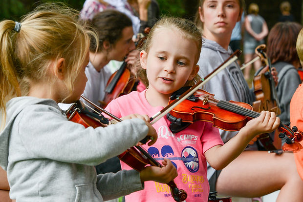 Two young fiddle students learning a tune by ear