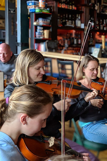 fiddle teachers and parents playing at local jam