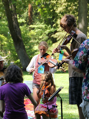 folk musicians playing together at jam with fiddlers
