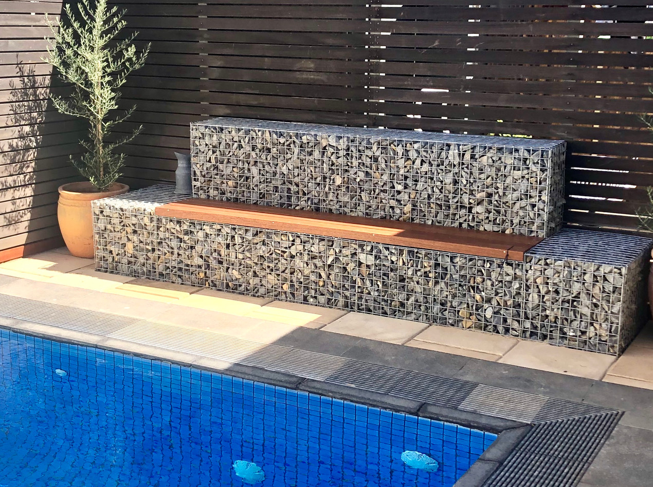 Rockweld poolside feature wall and seat