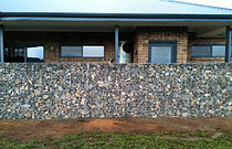 Wind deflector and privacy screen Gabion wall