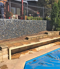 Feature and retaining wall to a pool area