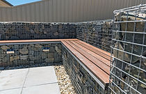Gabion outdoor corner bench seat and retaining wall