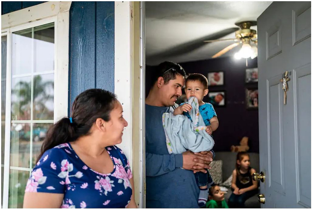 The $1.9 trillion coronavirus aid package includes a one-year expansion of the child tax credit, which experts predict will cut child poverty in half. Elizabeth Elias and Jose Espinoza, seen at home with their children in California's Central Valley, received $1,000 from Save the Children during the pandemic as their bills piled up. The initiative offers a preview of the expanded child tax credit's impact. (Melina Mara/The Washington Post)
