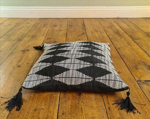 Black diamond tasseled cushion