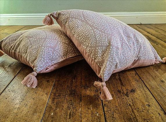Pink tassel cushion