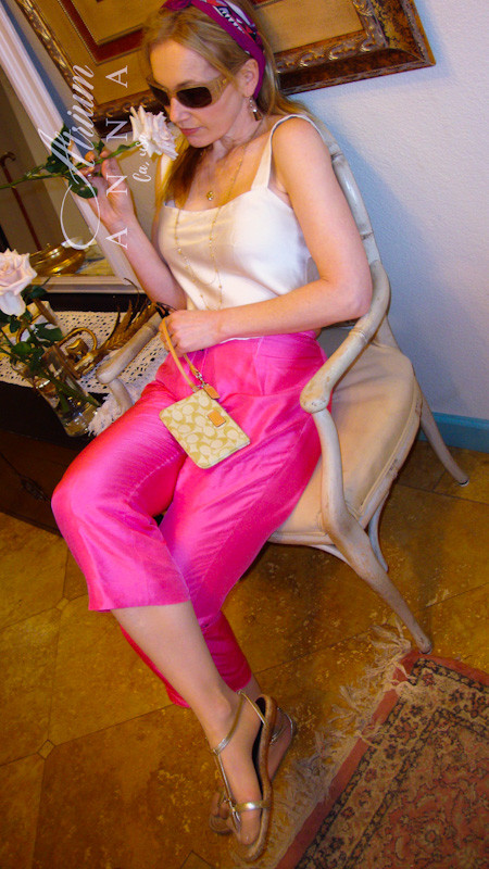 Romantic for Spring and Summer: Ralph Lauren pink silk capris with vintage handmade ivory silk top matched with MaxMara sunglasses, a vintage scarf, and a Coach wristlet.  Shop her look: Ralph Lauren silk pants (available in the store); Silk handmade top (available in the store) ; MaxMara sunglasses; Silk printed scarf; Coach wristlet; Burberry gold leather espadrilles.
