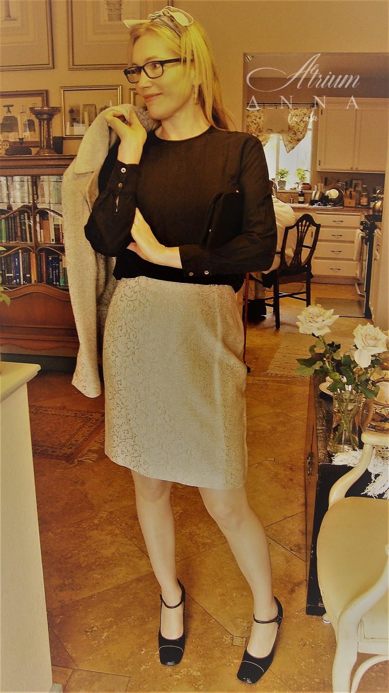 The same Emanuel Ungaro skirt suit with the blazer off shoulder to show her vintage black Norsdtrom top from the 80s.  Shop her look: Emanuel Ungaro skirt suit; Prada heels; Vintage black clutch; Printed silk scarf; Nordstrom black silk top
