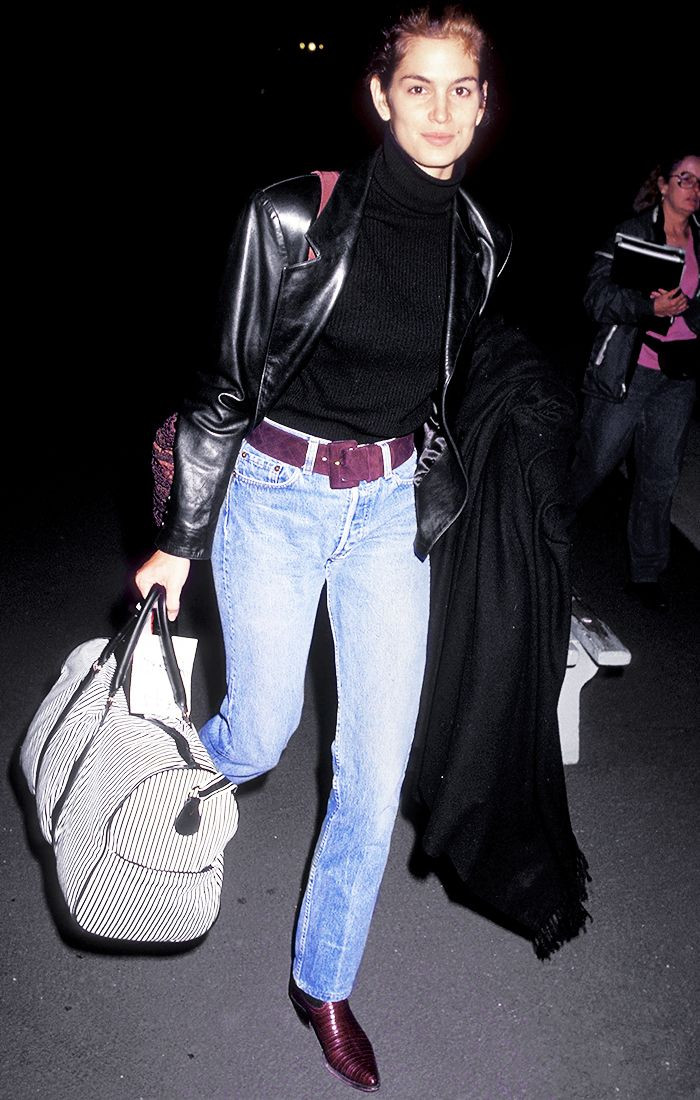 Cindy Crawford in high waisted jeans in the 90s