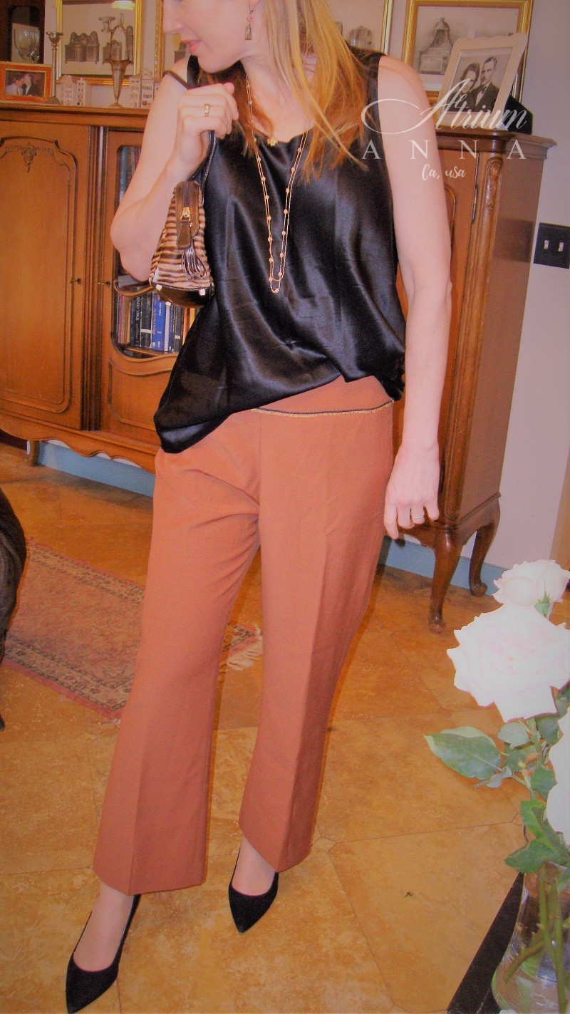 I really liked this combination on her because it was very feminine with all the gentle pieces: Nordstrom black silk sleeveless top (available in the shop); Blumarine front pleated brown business pants (available in the shop); Escada pony hair shoulder purse; Nine West black suede heels. Gabriel's own jewelry.