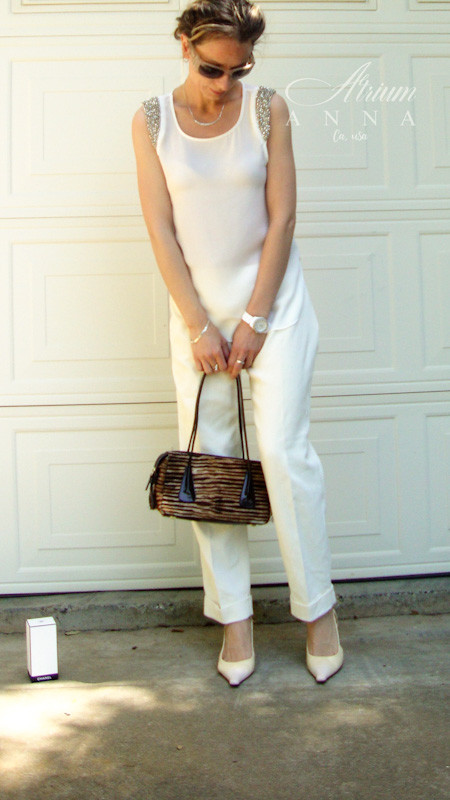 If you are one of those people who prefer to stay out of the spotlight but still want to be stylish, you will probably like this classic combination. We lifted up the look with the animal print purse that are especially trending this Season.  Anna wears: Socialite white sleeveless top; Brooks Brothers vintage ivory capri pants; Escada pony hair vintage purse; Prada ivory leather vintage sling backs, and a MaxMara vintage sunglasses.
