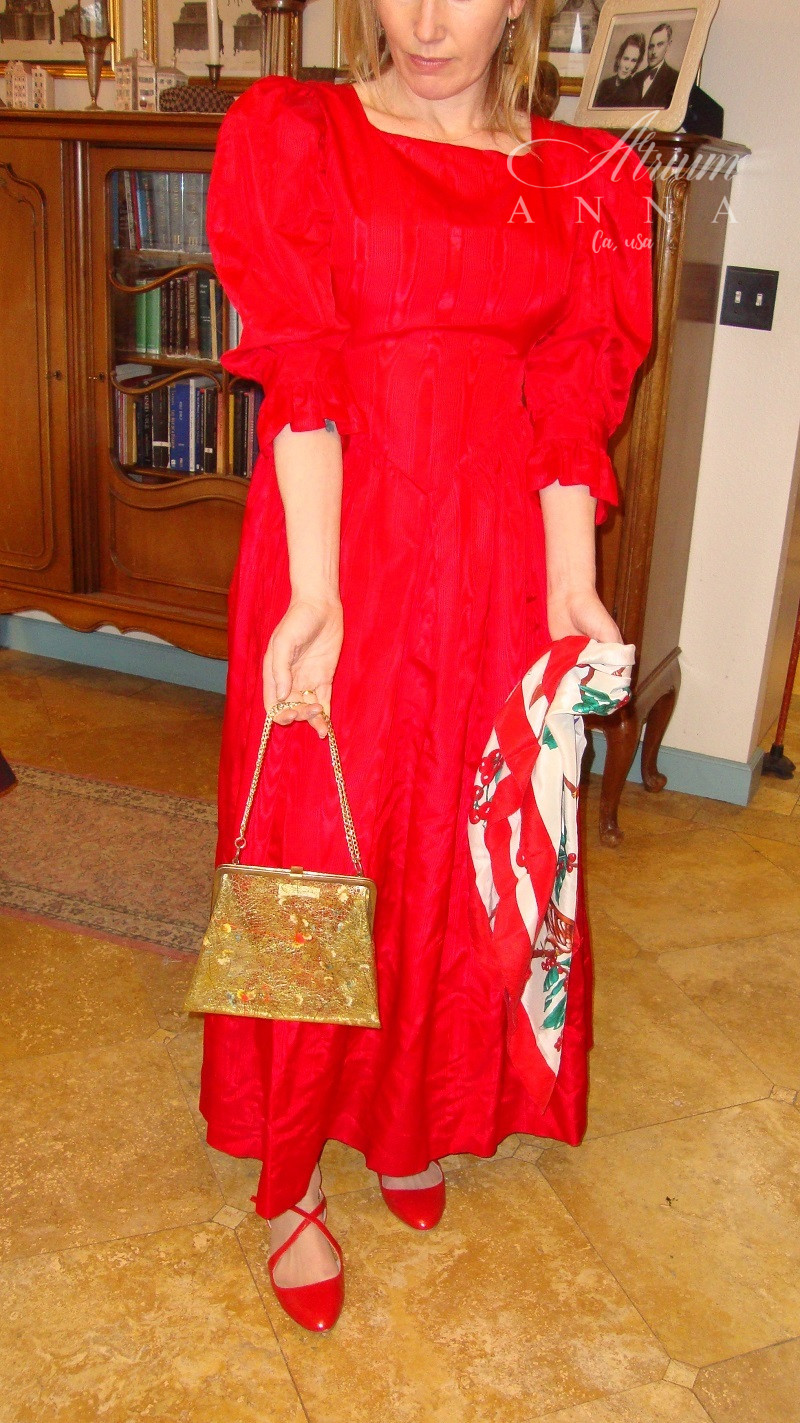 A more alternative look is this red vintage gown from the 80s with the fluffy shoulders. We matched it with a Charter's Club printed silk scarf, a vintage PVC floral chain handle little purse and a red Zara flat sandals.  Shop her look: Palomar Creations red gown; Zara sandals; Charter Club silk scarf; Vintage PVC purse