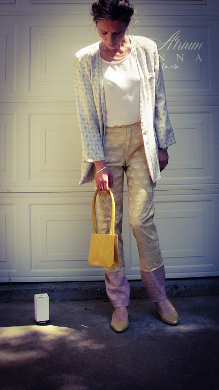 This pants requires special attention. It's from Christian Lacroix and has a beautiful balayage effect; the top part is pastel-golden yellow and the bottom is pastel pink. Just like a beautiful Summer sunset in California. The balzer is silk from the 80s by Nordstrom, the top is a modern Socialite piece, the purse is by Furla and the shoes are by Prada.  Anna wears: Christian Lacroix pants; Nordstrom silk blazer; Socialite white camisole top; Furla purse; Prada patent leather heels.