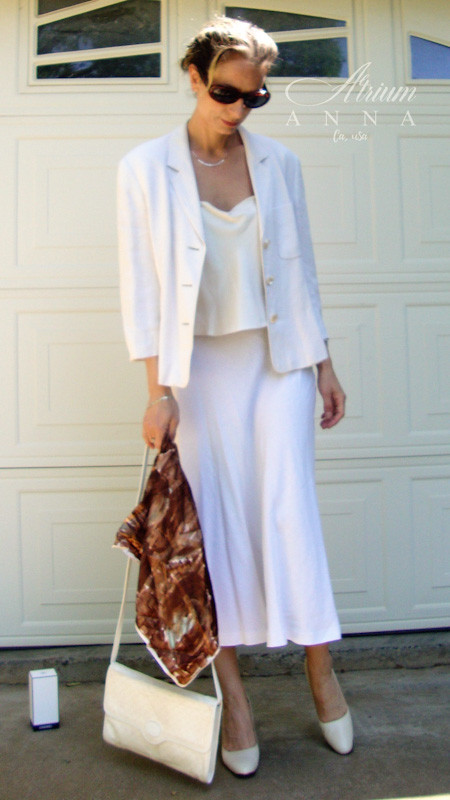 Talking about linen, yes, a favorite Spring material that is light enough and super comfortable. This is a soft and very feminine combination in vintage and high-end moods.  Anna wears: MaxMara off-white linen skirt suit; Silk vintage ivory sleeveless top; Gucci vintage purse; Balenciaga off-white vintage leather heels; Gianfranco Ferre vintage sunglasses; and a vintage silk scarf.