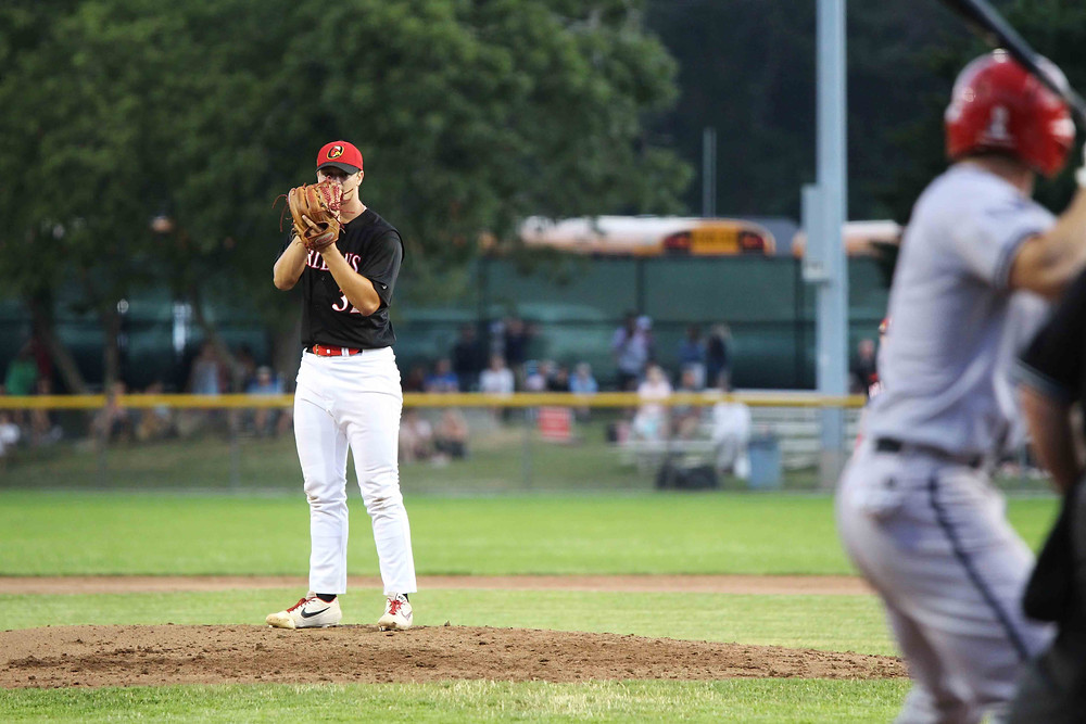 Michael Polk prepares to throw a pitch at Eldredge Park in Orleans