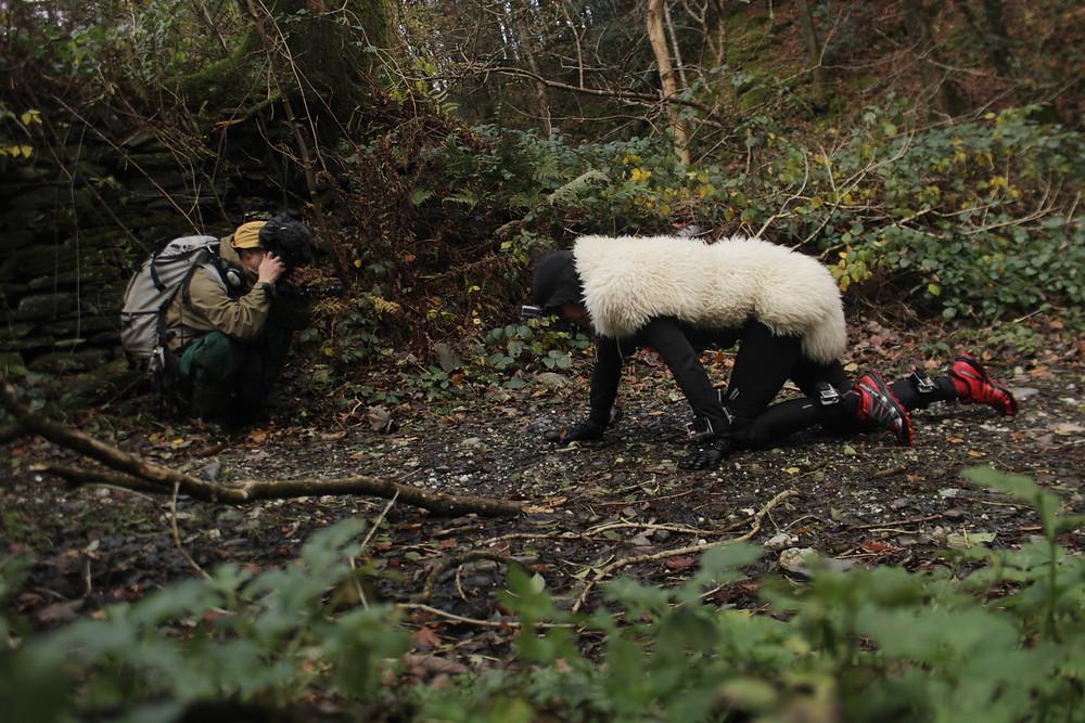 Miranda Whall crawling with sheep fleece