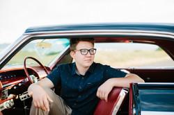 senior boy with car