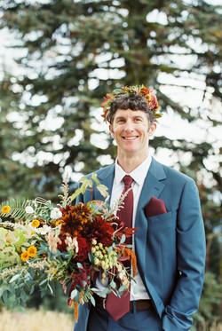 groom with flower grown