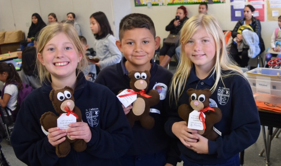 YWCA Silicon Receiving Teddy Bears for their Holiday Party