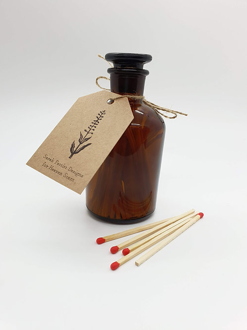 Brown Apothecary Bottle with Matches and strike paper on bottom