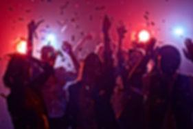 Young people dancing in night club.jpg