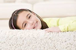 happy child laying on clean rug