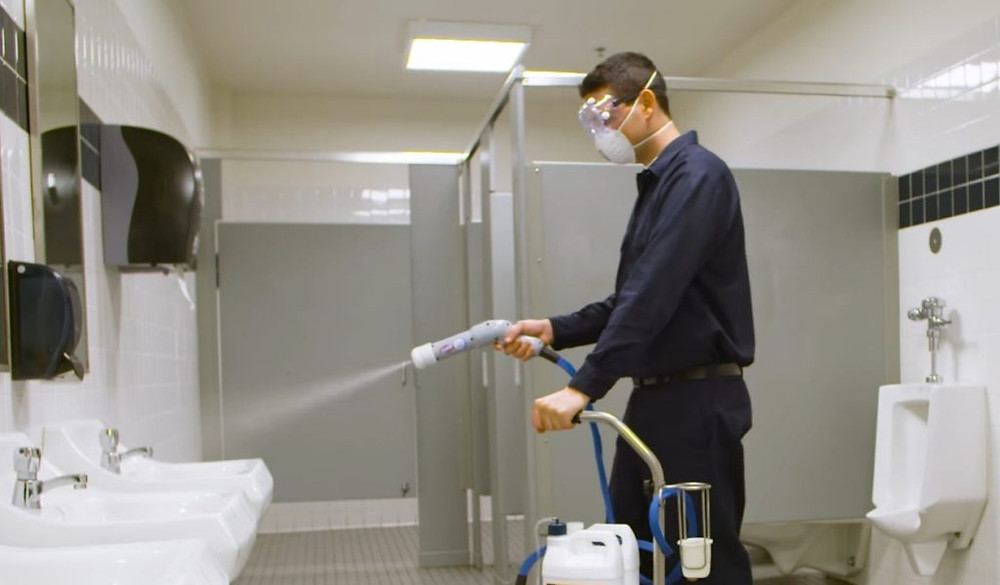 commercial cleaning professional disinfecting bathroom in phoenix az