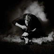 Photographe à Troyes, Portrait d'homme avec fumée en noir et blanc