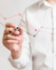 businessperson-s-hand-preparing-graphs-g
