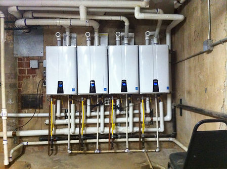 A line of Navien Tankless Water Heaters located in the basement of a fraternity house in Stillwater. Installed by Advantage.