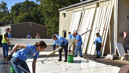 Electric co-op volunteers help Project Mend-A-House repair Woodbridge homes and donate $15,000