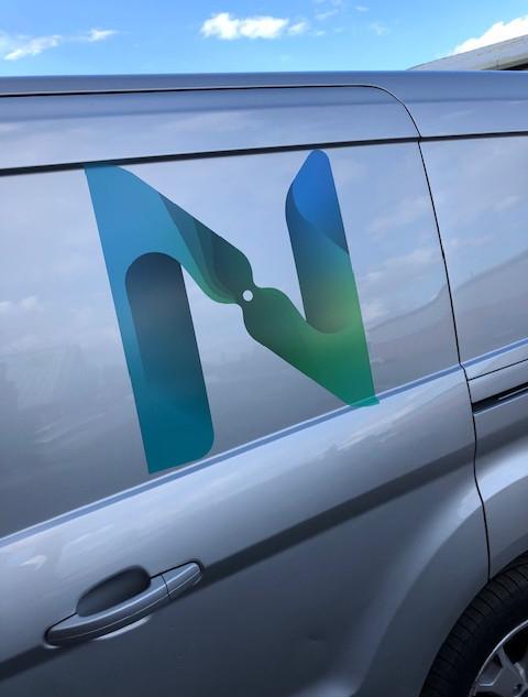 Green & blue logo onto silver van.jpg