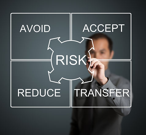 businessman writing risk management conc