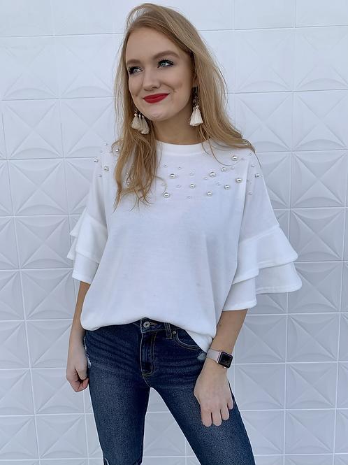 White pearl ruffle sleeve sweater
