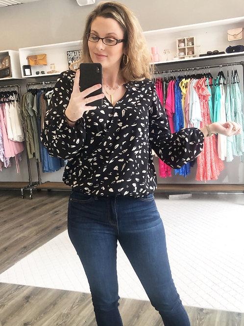 Black dotted wrap blouse