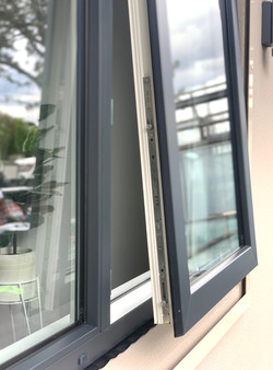 Open uPVC awning window in Tropical White/Anthracite Grey