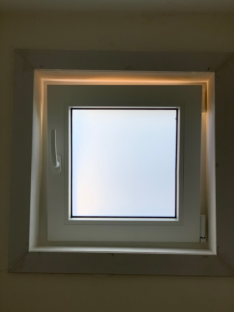 Tropical White Tilt and Turn window with white translucent laminated glass