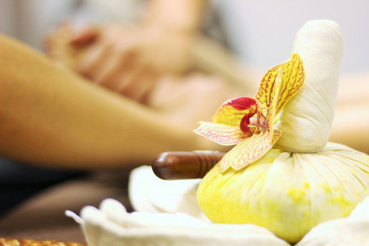 Massage with Herbal Compress