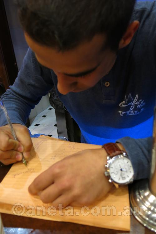 Bernardo Tinto signing his portrait