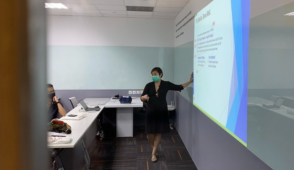 A woman is conducting a seminar on digital marketing