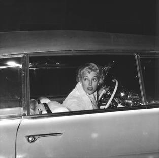 Ava Gardner driving her American convertible, via Veneto, Rome 1958