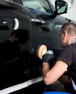 Man Polishing Car