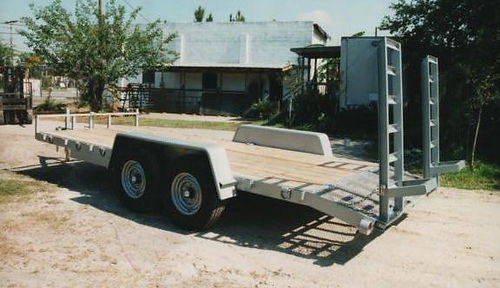 "6' 10"" x 18' equipment trailer with 7000 pound axles,dovetail,split ramps"