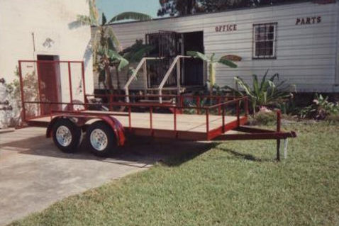 "6' 4""x14' tandem tailer with rear gate,3500 pound axles,aluminum wheels"