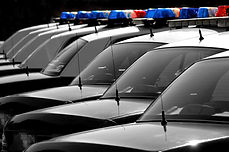 Row of Police Cars with Blue and Red Lig