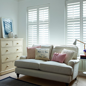 White Shutters in Living Room with Centr