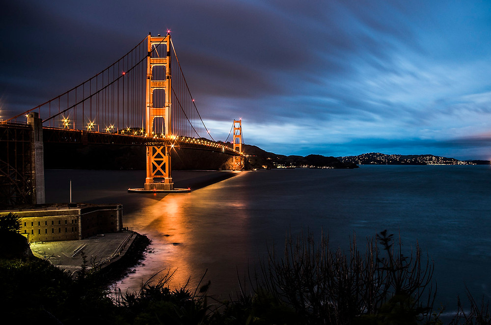 Golden Gate Bridge lit up at night