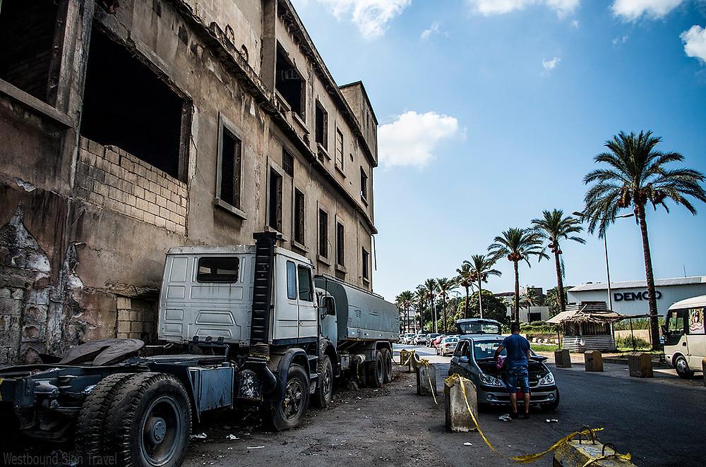 Taxi driver repairing his car in Bourj Hammoud, Beirut