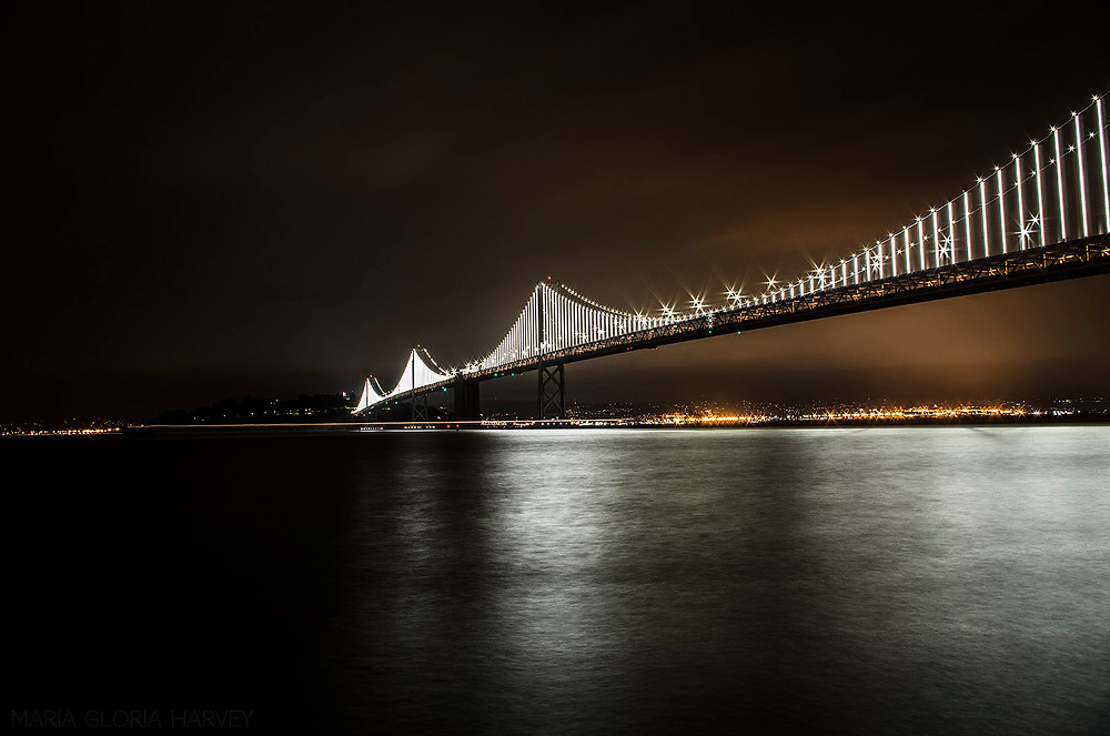 The San Francisco-Oakland Bay Bridge lit up at night